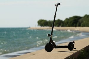 Glion Dolly Electric Scooter by the beach