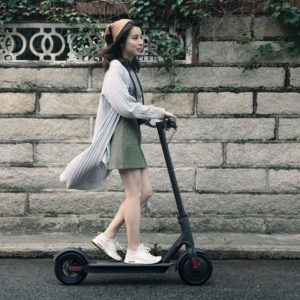 Girl Riding the Xiaomi Mi Electric Scooter