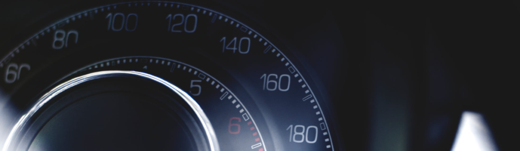 close up image of an analog speedometer