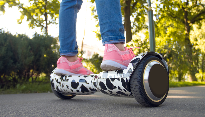 Girl feet on the hover board. Mini segway.