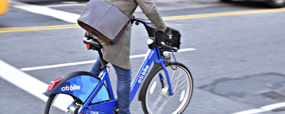 Businessman using a ride share bicycle