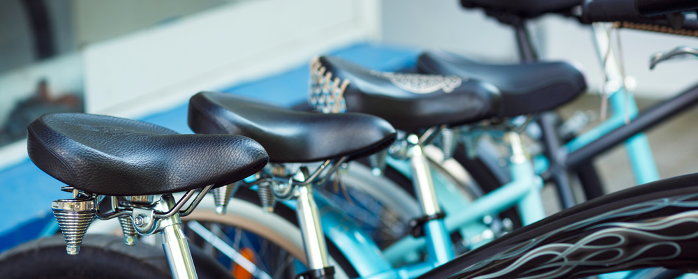 Close up of saddles of a group of bicycles on parking