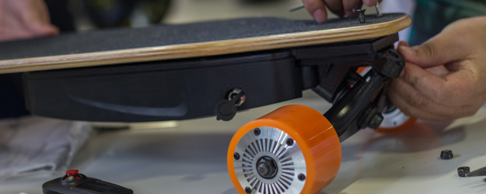 Man fixing electric skateboard