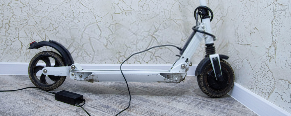 Charging the electric scooter battery