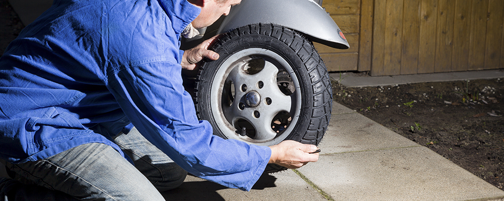 Checking scooter tire